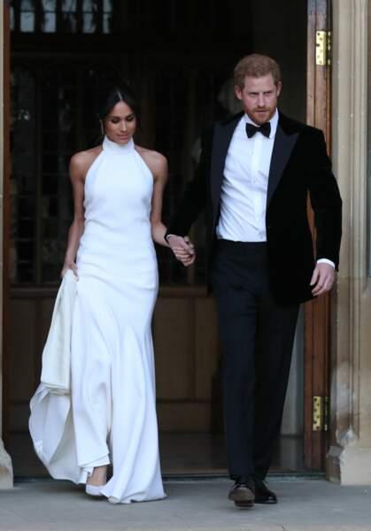 Meghan Markle affectionne particulièrement la marque Stella McCartney et portait une robe col bateau pour la réception de son mariage avec le prince Harry, le 19 mai 2018.