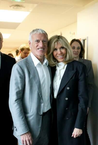 Brigitte Macron radieuse, prend la pose avec Didier Deschamps, parrain de l'opération Pièces Jaunes 2020 lors du lancement de la 31ème édition de l'opération Pièce Jaunes au Centre Hospitalier Régional d'Orléans le 8 janvier 2020.