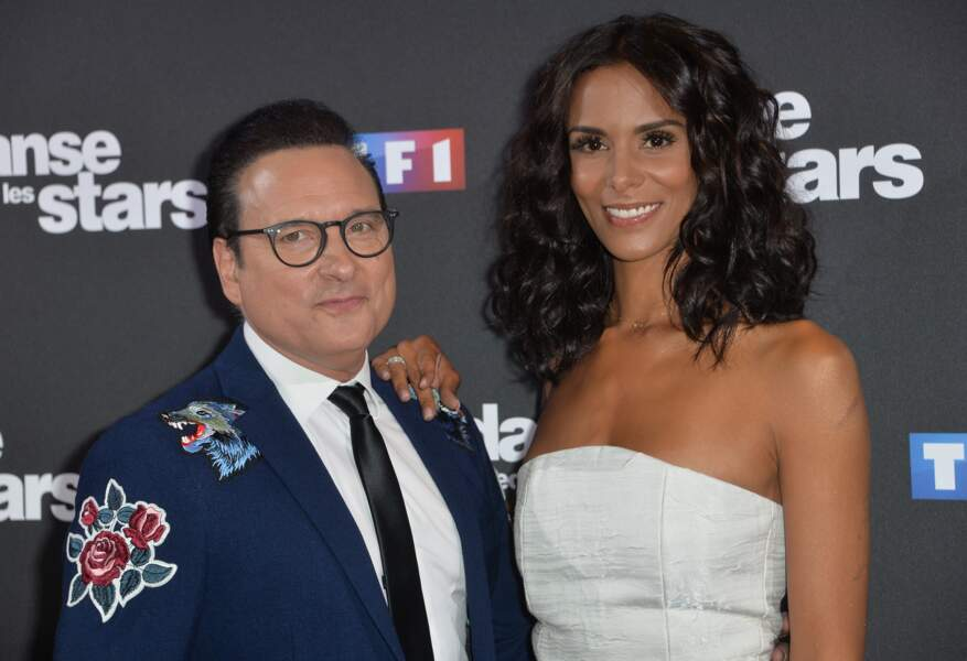 Shy'm les cheveux mi-longs et bouclés est accompagnée par Jean-Marc Généreux au photocall de la saison 10 de l'émission de DALS au siège de TF1 en septembre 2019.
