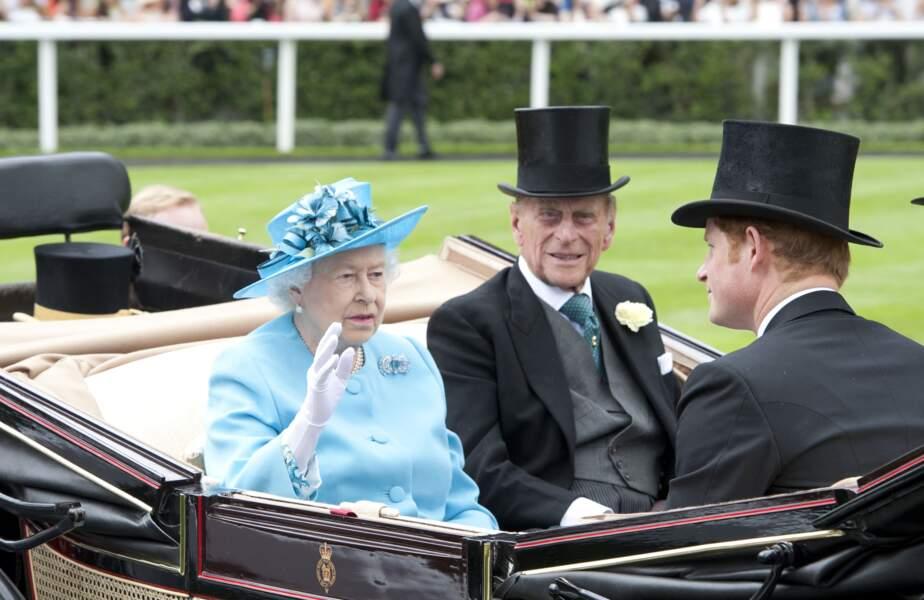 La reine Elisabeth II, le prince Philip et Harry à Ascot, en 2014.