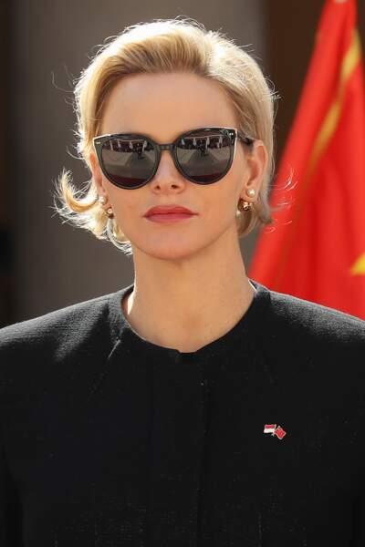 Charlene de Monaco est aussi une grande amoureuse des lunettes de soleil, ici avec un modèle xxl, le 24 Mars 2019.
