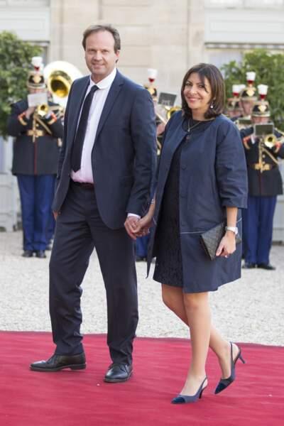 Anne Hidalgo et son mari Jean-Marc Germain arrivent à l'Elysée main dans la main en 2015