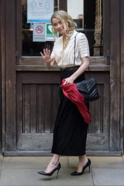 Amber Heard, à son arrivée à la cour royale de justice à Londres, pour le procès en diffamation contre le magazine The Sun, le 21 juillet 2020.