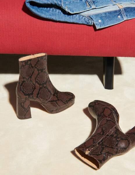 Boots en cuir imprimé python, 295€, Sandro