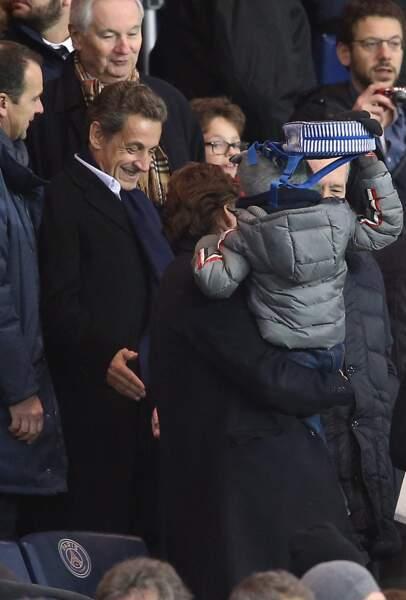 Nicolas Sarkozy, avec Jean Sarkozy et son petit-fils Solal, lors d'un match PSG - Angers au Parc des Princes à Paris, le 23 Janvier 2016.