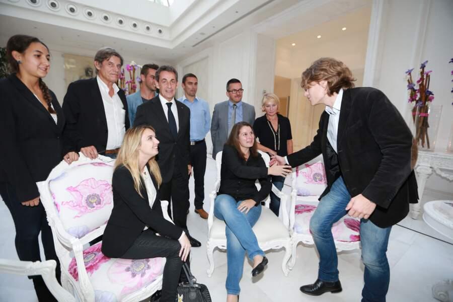 Nicolas Sarkozy et son fils Jean Sarkozy, lors d'une rencontre avec les lecteurs de Nice-Matin, en octobre 2014.