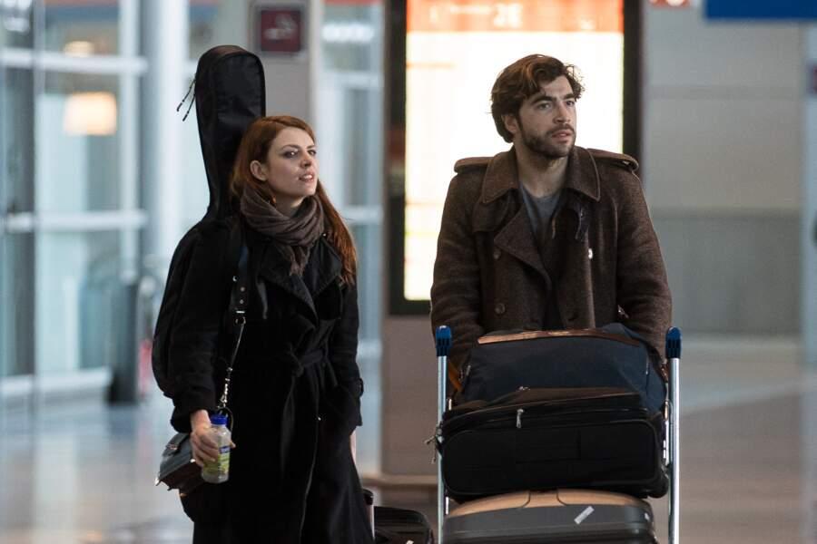 Elodie Frégé et son fiancé Gian Marco Tavani arrivent à l'aéroport Roissy CDG, le 25 février 2019