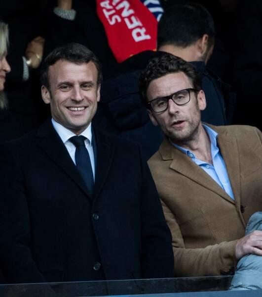 Emmanuel Macron et son frère cadet Laurent, 41 ans, lors d'un événement sportif au stade de France, le 27 avril 2019.