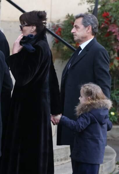 Nicolas Sarkozy, sa femme Carla Bruni Sarkozy et leur fille Giulia aux obsèques d'Andrée Sarkozy, la mère de l'ancien président de la République.