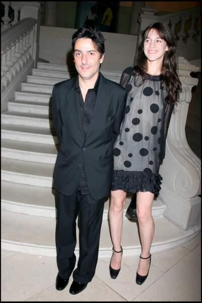 Yvan Attal et Charlotte Gainsbourg, à l'exposition Balenciaga, en 2006.
