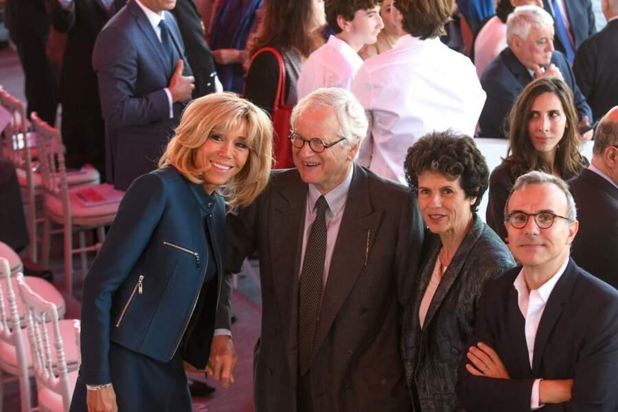 Brigitte Macron, au côté, entre autres, de Philippe Besson, lors d'une parade place de la Concorde, le 14 juillet 2017.