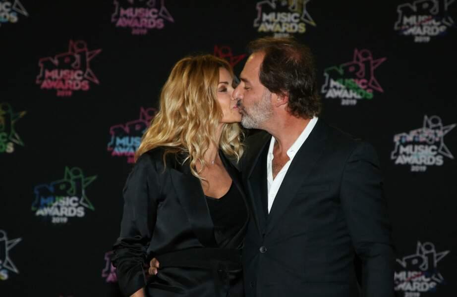 Ingrid Chauvin, avec son mari Thierry Peythieu, 21ème édition des NRJ Music Awards au Palais des festivals à Cannes le 9 novembre 2019. Le couple s'est séparé en novembre 2020.