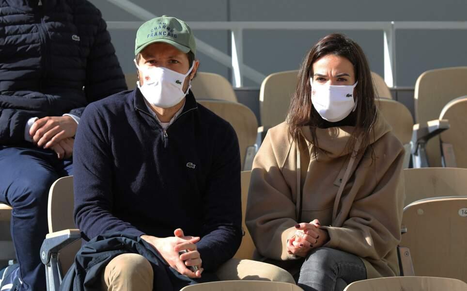 Vianney Bureau et sa compagne Catherine Robert en tribune lors des internationaux de tennis de Roland Garros à Paris le 4 octobre 2020.