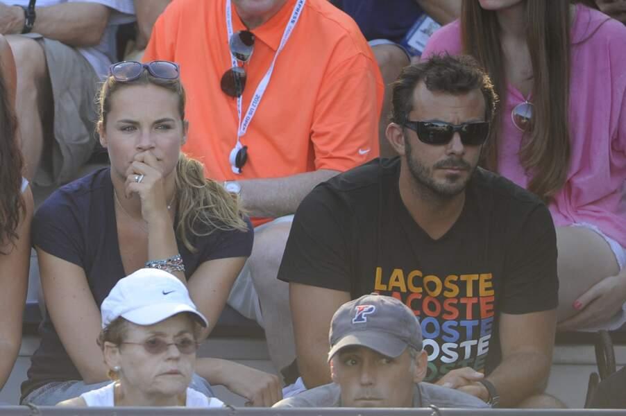 Melanie Maudran et son mari Thierry Ascione en 2012 dans les tribunes de l'US Open Championships à New York.