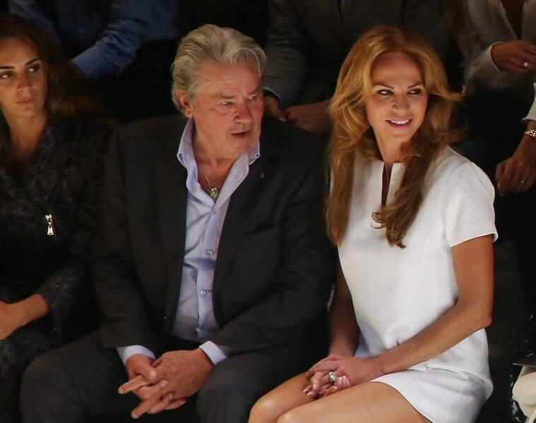 Alain Delon et Rosalie Van Breemen au defilé de mode Elie Saab à Paris le 03/10/2012