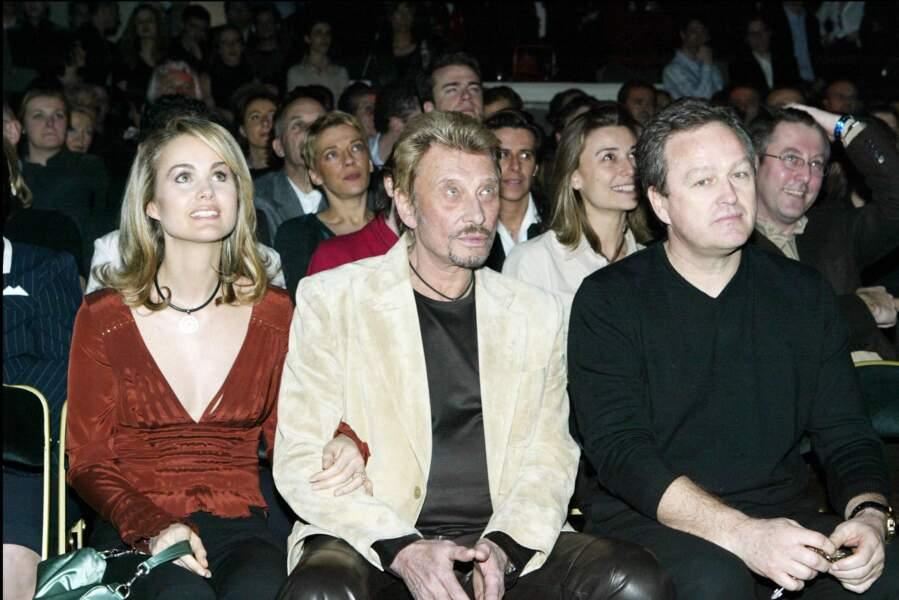 Laeticia Hallyday, avec Johnny et André Boudou, à L'Amnesia Paris, en 2004