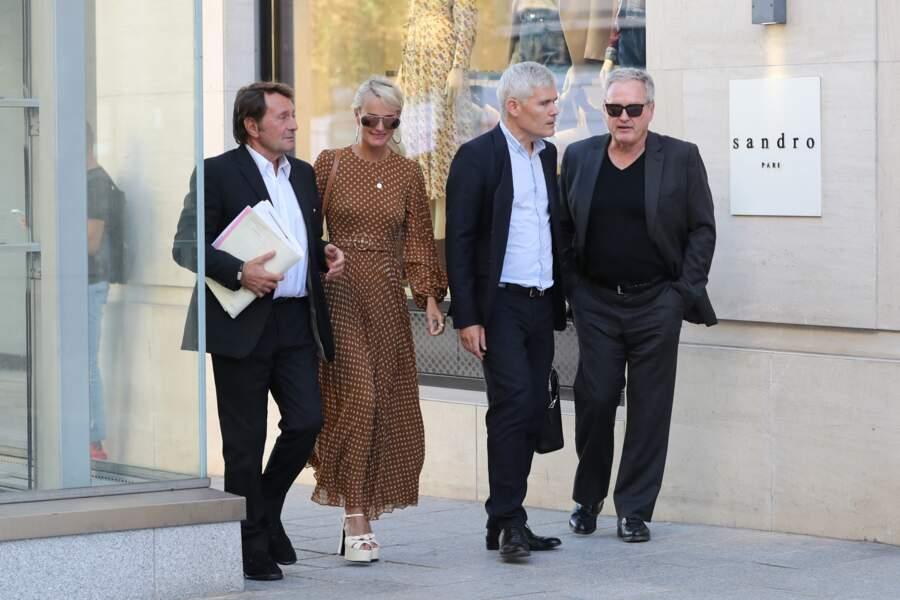 Laeticia Hallyday, avec André Boudou et ses avocats, à Paris, en septembre 2019