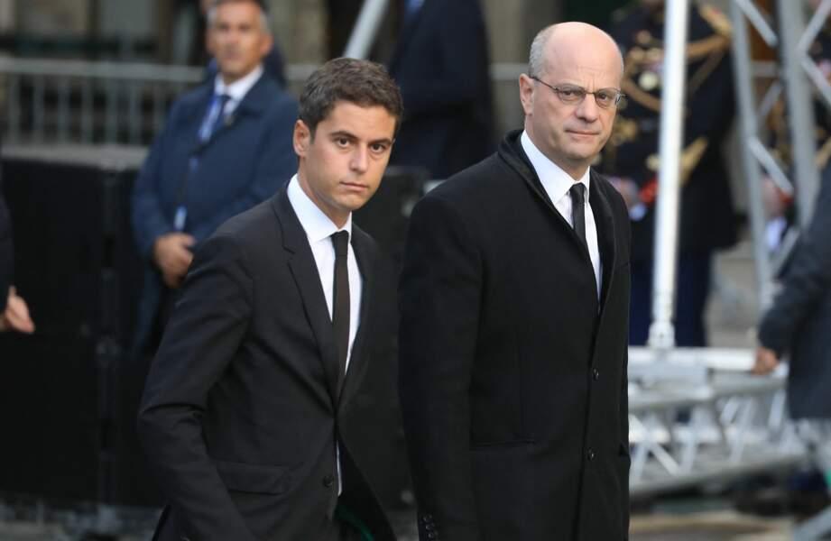 Gabriel Attal et Jean-Michel Blanquer arrivent ensemble à l'église de Saint-Sulpice pour les obsèques de Jacques Chirac, à Paris, le 30 septembre 2019.