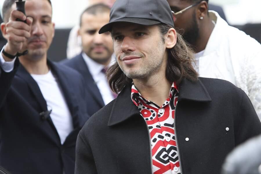 Orelsan à sa sortie du défilé Chanel, au Grand Palais, à Paris, le 1er octobre 2019.