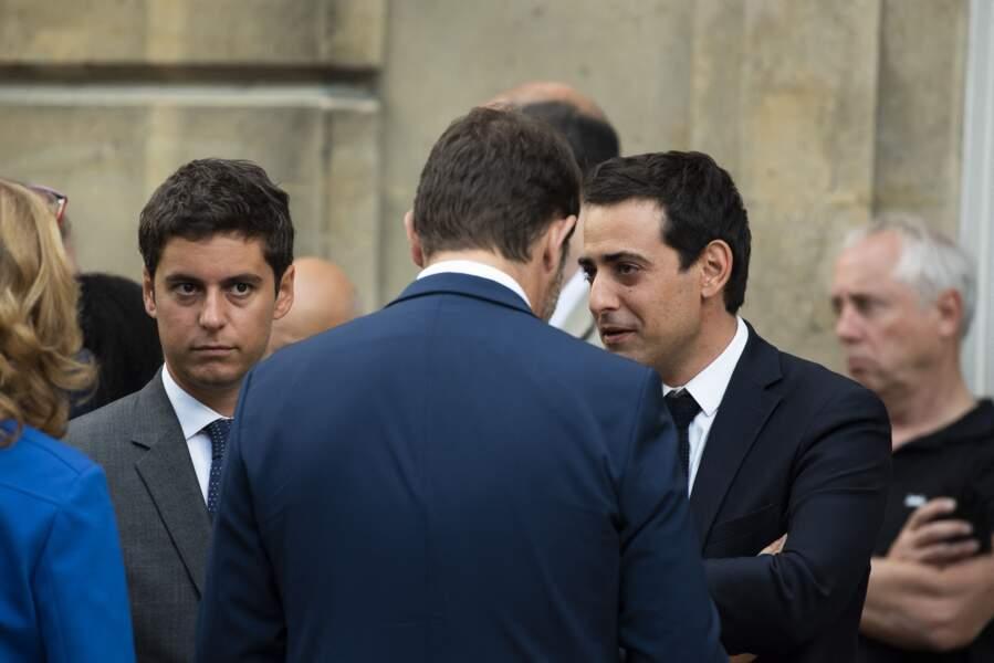 Gabriel Attal et Stéphane Séjourné, au côté de Christophe Castaner, lors d'un discours aux armées d'Emmanuel Macron l'Hôtel de Brienne, siège du ministère des Armées, le 13 juillet 2019.