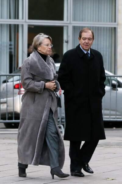 Michèle Alliot-Marie et son compagnon Patrick Ollier aux obsèques de Jacques Barrot à Paris, le 8 décembre 2014