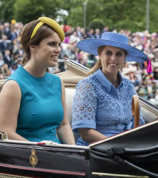 Eugenie et Beatrice d'York, lors de la première journée des courses d'Ascot 2019, à Ascot, le 18 juin 2019.