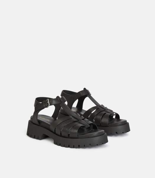 "Sandales plates noires ""Hellha"", Minelli, 129 euros."
