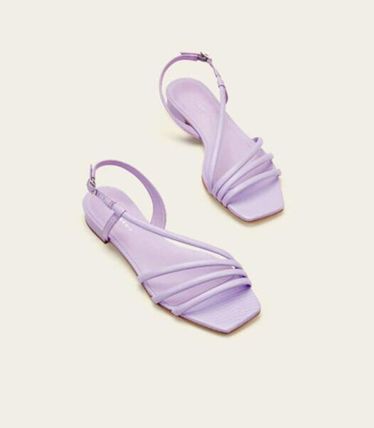 """Sandales plates en cuir lilas """"Zurich"""", Cosmoparis, 110 euros."""