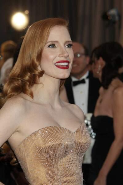 Les boucles blond vénitien effet glossy de Jessica Chastain aux Oscars 2013