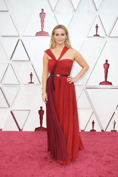 Reese Witherspoon en robe plissée haute couture Dior et bijoux Bulgari lors de la 93e cérémonie des Oscars le 25 avril 2021.