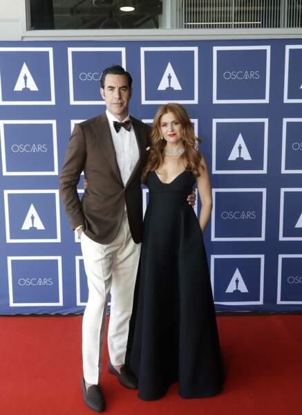 Sacha Baron Cohen en Ralph Lauren des pieds à la tête et Isla Fisher en Dior et bijoux Bulgari lors de la 93e cérémonie des Oscars le 25 avril 2021.
