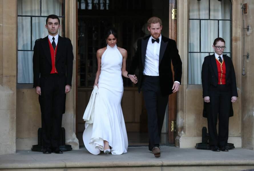 19 mai 2018 : Meghan et Harry en tenue de soirée se rendent à la réception de leur mariage