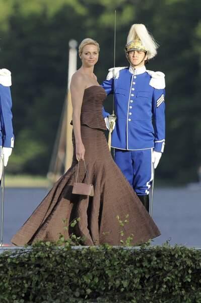 8 juin 2013 : Charlene en robe Akris pour le mariage de Madeleine de Suède