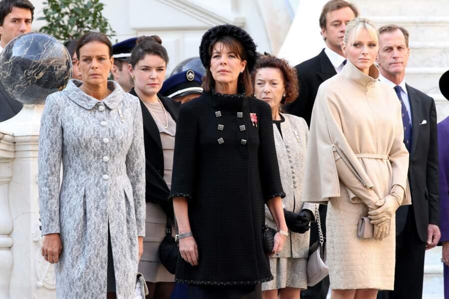 Charlene de Monaco remplit son rôle, aux côtés de Stéphanie et Caroline, lors de la Fête nationale monégasque, à Monaco, le 19 novembre 2011