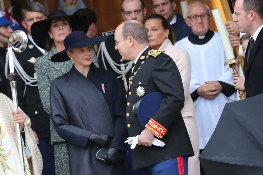 Charlene de Monaco complice avec son époux, sous le regard de Caroline et Stéphanie, à la sortie de la céremonie du Te Deum en la cathédrale Notre-Dame-Immaculee, le jour de la Fête nationale monégasque, à Monaco, le 19 novembre 2013