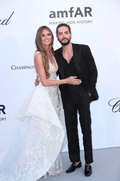 Heidi Klum à l'Amfar en 2012 : glamour en robe longue transparente  avec son compagnon Tom Kaulitz.