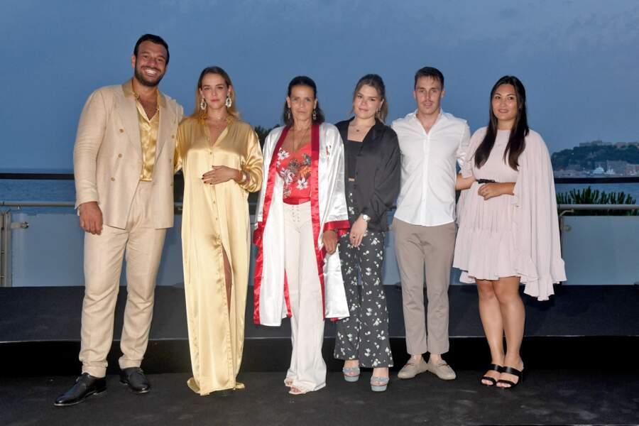 La princesse Stéphanie de Monaco entourée de ses trois enfants durant la traditionnelle soirée d'été de Fight Aids Monaco, le 24 juillet