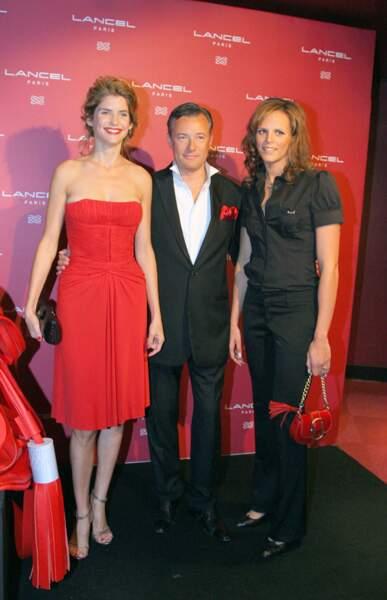 Alice Taglioni en 2009 : robe rouge. bustier, chignon et bouche rouge