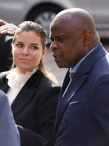 Sophie Tapie et Basile Boli lors de la messe funéraire en hommage à Bernard Tapie en l'église Saint-Germain-des-Prés à Paris, le 6 octobre 2021