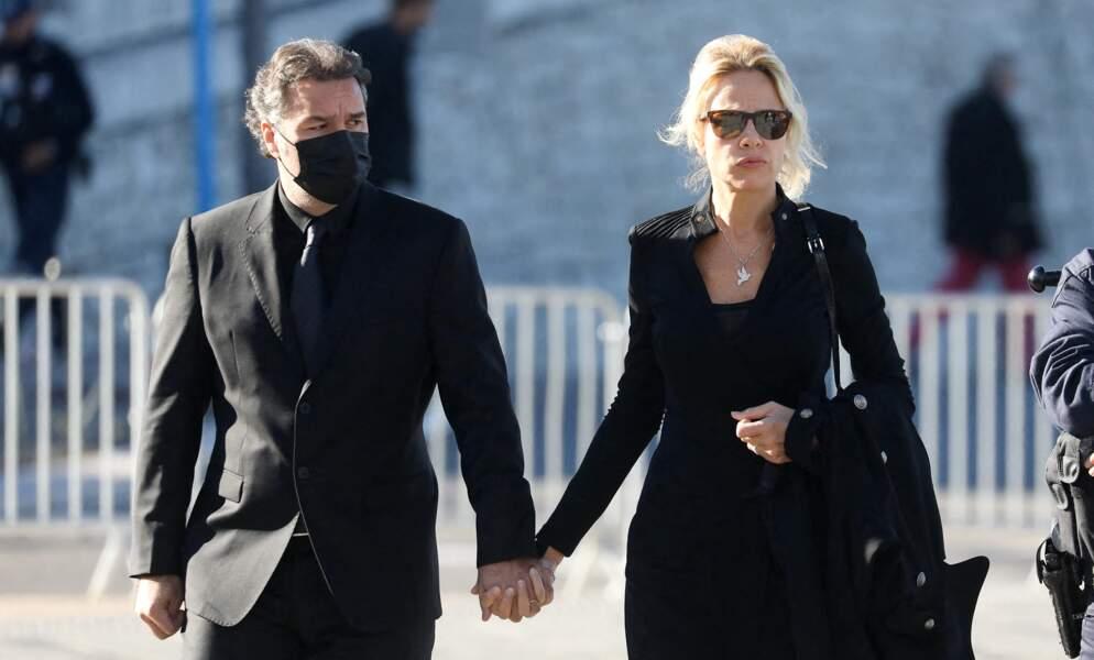 Laurent Tapie et sa femme aux obsèques de Bernard Tapie, en la cathédrale de la Major, à Marseille, le 8 octobre 2021.